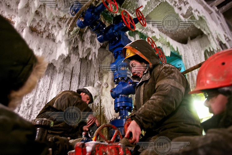 Workers test a gas drilling facility at the Kumzhinskoe Gas Field, located in the delta of Pechora River, 60 km from Narjan-Mar, a city in Russia's Arctic. In 1979, an explosion in one of the wells caused an uncontrolled gas fountain, with the condensate polluting huge areas of the tundra around, including the Pechora River. In May 25, 1981, the Soviets tried to collapse the field with an underground nuclear explosion at 1470 m depth. The explosion caused even more damage and pollution. After that the field was closed and the area marked a nature reserve. Recently, more gas was found in the area. In 2007, then-President Vladimir Putin signed a decree demarcating the area from the nature reserve so that drilling work can begin. /Felix Features
