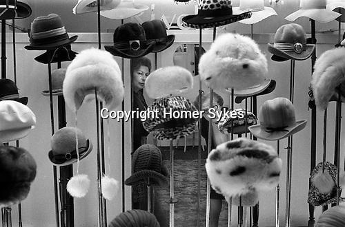 Hat Shop and women assistants. East End London Mile End Road. 1974...