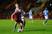 Lincoln City's Conor McGrandles is tackled by Manchester City U21's Adrian Berbnabe, but his appeals for a penalty were turned down<br /> <br /> Photographer Chris Vaughan/CameraSport<br /> <br /> EFL Papa John's Trophy - Northern Section - Group E - Lincoln City v Manchester City U21 - Tuesday 17th November 2020 - LNER Stadium - Lincoln<br />  <br /> World Copyright © 2020 CameraSport. All rights reserved. 43 Linden Ave. Countesthorpe. Leicester. England. LE8 5PG - Tel: +44 (0) 116 277 4147 - admin@camerasport.com - www.camerasport.com