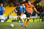 St Johnstone v Dundee United.....01.04.13      SPL.Nigel Hasselbaink and Barry Douglas.Picture by Graeme Hart..Copyright Perthshire Picture Agency.Tel: 01738 623350  Mobile: 07990 594431