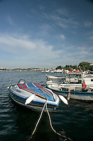 Boats on the Golden Horn, Istanbul, Turkey. The Topkapi Palace, Blue Mosque and Hagia Sophia are in the background