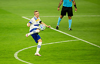 LOS ANGELES, CA - SEPTEMBER 02: Jackson Yueill #14 of the San Jose Earthquakes smashes a volly during a game between San Jose Earthquakes and Los Angeles FC at Banc of California stadium on September 02, 2020 in Los Angeles, California.