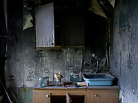 What used to be someone's kitchen stands destroyed in a burned out residential building in the town of Krasnohorivka. The frontline between Ukrainian government forces and the positions of Russian-backed separatists is closeby.