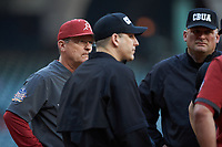 Arkansas Razorbacks head coach Dave Van Horn listens as the umpires discuss a call during the game against the Oklahoma Sooners in game two of the 2020 Shriners Hospitals for Children College Classic at Minute Maid Park on February 28, 2020 in Houston, Texas. The Sooners defeated the Razorbacks 6-3. (Brian Westerholt/Four Seam Images)