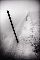 Fence posts along foggy beach<br />