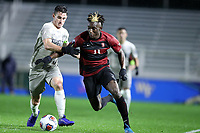 CARY, NC - DECEMBER 13: Ousseni Bouda #11 of Stanford University and Dylan Nealis #12 of Georgetown University challenge for the ball during a game between Stanford and Georgetown at Sahlen's Stadium at WakeMed Soccer Park on December 13, 2019 in Cary, North Carolina.