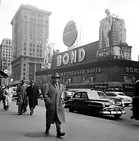 Undated  File photo (circa 1955) - A man walk in front of Bond store in New-York  City
