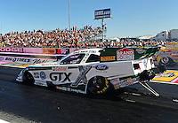 Oct. 30, 2011; Las Vegas, NV, USA: NHRA funny car driver Mike Neff during the Big O Tires Nationals at The Strip at Las Vegas Motor Speedway. Mandatory Credit: Mark J. Rebilas-