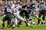 Kansas State Wildcats defensive end Meshak Williams (42) and Kansas State Wildcats defensive back Jarard Milo (23) tackle TCU Horned Frogs running back Matthew Tucker (29) during the game between the Kansas State Wildcats and the TCU Horned Frogs  at the Amon G. Carter Stadium in Fort Worth, Texas. Kansas State defeats TCU 23 to 10...