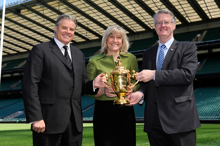 (L-R) IRB CEO and RWCL Managing Director Brett Gosper, England Rugby 2015 Chief Executive Debbie Jevans and IRB and RWCL Chairman Bernard Lapasset with the Webb Ellis Trophy  during the Rugby World Cup 2015 Venues and Match Schedule Launch at Twickenham Stadium on Thursday 2nd May 2013 (Photo by Rob Munro)