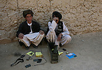 Two suspected Taliban recruits await questioning by U.S. and Afghan soldiers in the Shah Joy district of southern Afghanistan's Zabul province. The boys were found at a madrassa, or religious school, that local villagers said was controlled by the Taliban. The one in the dark jacket admitted to being the younger brother of the school's prayer leader, a locally-known Taliban figure. Afghan forces detained him, and let the other one go. Oct. 26, 2010. DREW BROWN/STARS AND STRIPES