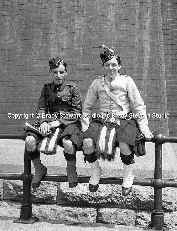 Toronto Ontario:  Two young members of the 48th Highlanders after one of the parades celebrating the 100th anniversary of the Battle of Lundy's Lane.