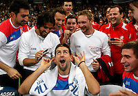 Novak Djokovic (center)gets a celebratory haircut by Janko Tipsarevic on the court right after the Serbian national tennis team won the Davis Cup finals against France in Belgrade Arena, Belgrade, Serbia, Sunday, December. 5, 2010. (credit & photo: Pedja Milosavljevic/SIPA PRESS)