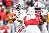 Indianapolis, IN - DEC 7, 2019: Ohio State Buckeyes quarterback Justin Fields (1) looks downfield to pass during Big Ten Championship game between Wisconsin and Ohio State at Lucas Oil Stadium in Indianapolis, IN. Ohio State came back from a 21-7 deficit at halftime to beat Wisconsin 34-21 to win its third straight Big Ten Championship. (Photo by Phillip Peters/Media Images International)