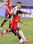 Real Madrid's Mariano Diaz (b) and RCD Mallorca's Luka Moreno, youngest rookie in LaLiga history, during La Liga match. June 24,2020. (ALTERPHOTOS/Acero)