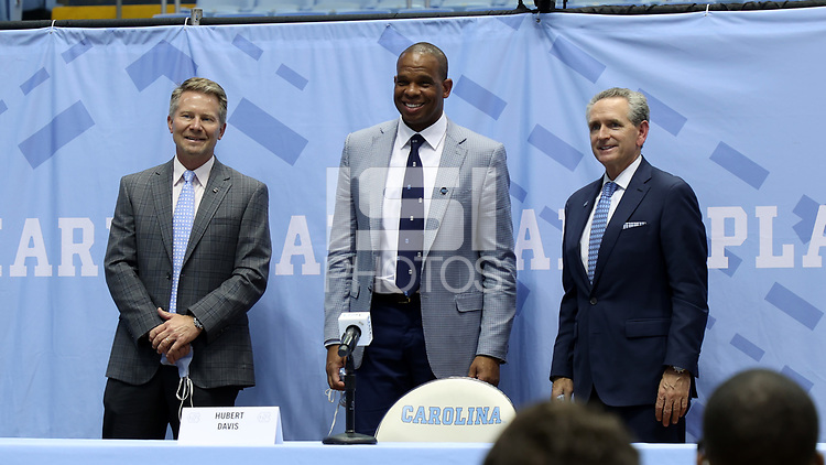CHAPEL HILL, NC - APRIL 6: UNC men's basketball head coach Hubert Davis poses with Chancellor Kevin Guskiewicz and Athletic Director Bubba Cunningham after his introductory press conference at Dean E. Smith Center on April 6, 2021 in Chapel Hill, North Carolina.
