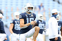 CHAPEL HILL, NC - OCTOBER 10: Beau Corrales #15 of North Carolina stretches before a game between Virginia Tech and North Carolina at Kenan Memorial Stadium on October 10, 2020 in Chapel Hill, North Carolina.