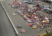 Busy, crowded pit road during pit stops in the Southern 500 at Darlington Raceway in Darlington, SC in September 1988. (Photo by Brian Cleary/www.bcpix.com)