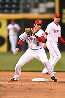 Harrisburg Senators second baseman Rick Hague (5) tags out first baseman Kennys Vargas (not shown) on an attempted steal during a game against the New Britain Rock Cats on April 28, 2014 at Metro Bank Park in Harrisburg, Pennsylvania.  Harrisburg defeated New Britain 9-0.  (Mike Janes/Four Seam Images)