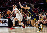 COLLEGE PARK, MD - DECEMBER 28: Faith Masonius #13 of Maryland dribbles past Priscilla Smeenge #2 of Michigan. during a game between University of Michigan and University of Maryland at Xfinity Center on December 28, 2019 in College Park, Maryland.