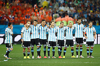 The Argentina team watch on nervously during the penalty shoot out