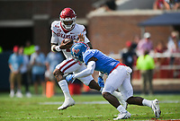 Arkansas quarterback Malik Hornsby (4) carries the ball, Saturday, October 9, 2021 during the second quarter of a football game at Vaught Hemingway Stadium in Oxford, Miss. Check out nwaonline.com/211010Daily/ for today's photo gallery. <br /> (NWA Democrat-Gazette/Charlie Kaijo)