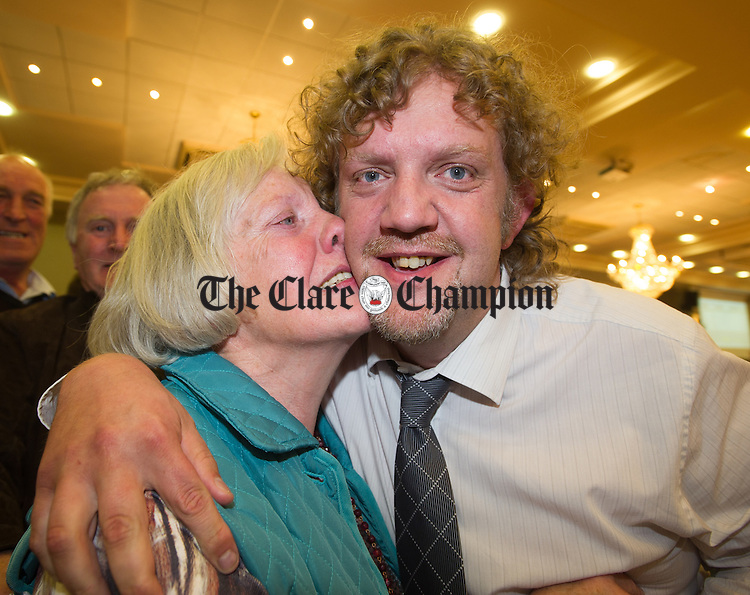 Fianna Fail's Alan O Callaghan is congratulated by his mother Breda following his victory at the election count at The West county Hotel, Ennis. Photograph by John Kelly.
