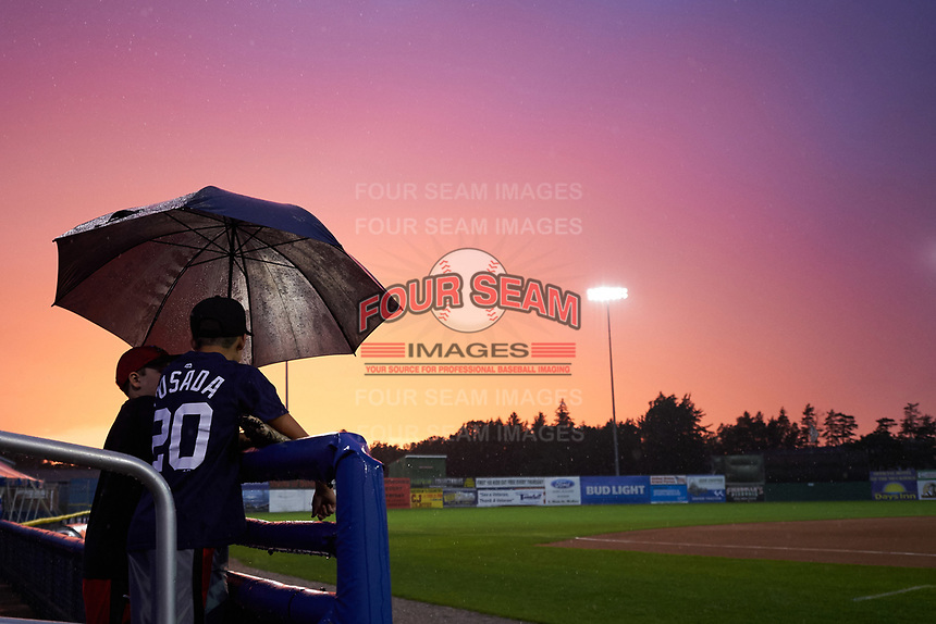 Batavia Muckdogs fans wait out a rain delay during a game against the Tri-City ValleyCats on July 14, 2017 at Dwyer Stadium in Batavia, New York.  Batavia defeated Tri-City 8-4.  (Mike Janes/Four Seam Images)
