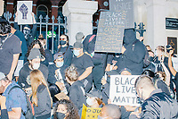 """Thousands gathered outside the Massachusetts State House in Boston, Massachusetts, on Sun., May 31, 2020, to demonstrate against police brutality after the killing by police of George Floyd in Minneapolis, Minnesota, the previous week. Protests, sometimes violent, have erupted around the United States. This protest was organized by an organization called Black Boston. Protesters often chanted """"Black Lives Matter"""" and """"Fuck the police."""" The protest began at 6:30pm in various parts of the city, and around 9pm, after most protesters had left, there began to be clashes between people and police, especially in the Downtown Crossing area of Boston and around Boston Common.  The protest signs here includes the names of African Americans killed by police over the last decade in the US including George Floyd, Breonna Taylor, Amaud Arbury, Trayvon Martin, Tamir Rice, and others. Other signs read """"Black Lives Matter."""""""