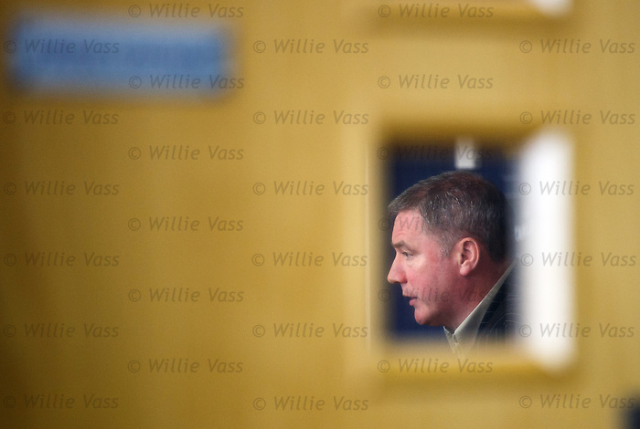 Ally McCoist faces the media at the training centre