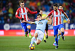 Jonathan Castro Otto, Jonny, (c) of RC Celta de Vigo battles for the ball with Antoine Griezmann (l) and Yannick Ferreira Carrasco of Atletico de Madrid during their La Liga match between Atletico de Madrid and RC Celta de Vigo at the Vicente Calderón Stadium on 12 February 2017 in Madrid, Spain. Photo by Diego Gonzalez Souto / Power Sport Images