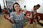 """THIS PHOTO IS AVAILABLE AS A PRINT OR FOR PERSONAL USE. CLICK ON """"ADD TO CART"""" TO SEE PRICING OPTIONS.   Katarina Atanazova prays during a worship service in the largely Roma neighborhood of Gorno Ezerovo, part of the Bulgarian city of Burgas. Residents here don't self-identify much as Roma, however, because of the negative connotations associated with the word, so many refer to themselves as a Turkish-speaking minority."""