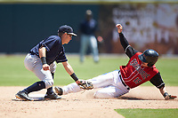 Kyle Gray (9) of the Charleston RiverDogs fields a throw as Matt Whatley (19) of the Hickory Crawdads slides into second base at L.P. Frans Stadium on May 13, 2019 in Hickory, North Carolina. The Crawdads defeated the RiverDogs 7-5. (Brian Westerholt/Four Seam Images)