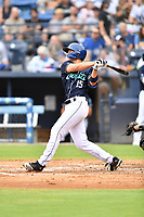 Asheville Tourists C.J. Stubbs (15) swings at a pitch during a game against the Aberdeen IronBirds on June 19, 2021 at McCormick Field in Asheville, NC. (Tony Farlow/Four Seam Images)