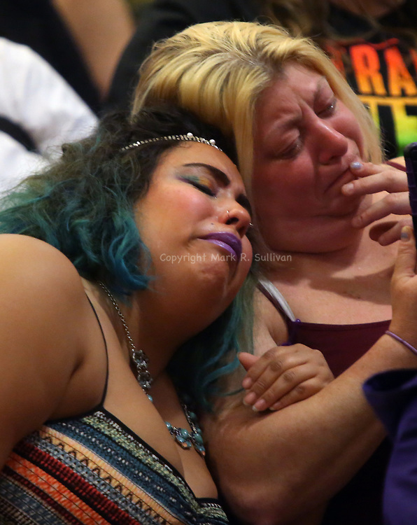 A vigil for the victims of the Orlando nightclub shooting was hosted by The Pride Center of New Jersey and was held at the Reformed Church of Highland Park on Tuesday June 14, 2016.<br /> Women openly weep as the names of the victims are read aloud.