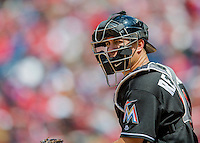 15 May 2016: Miami Marlins catcher J.T. Realmuto glances back to the dugout for a sign during a game against the Washington Nationals at Nationals Park in Washington, DC. The Marlins defeated the Nationals 5-1 in the final game of their 4-game series.  Mandatory Credit: Ed Wolfstein Photo *** RAW (NEF) Image File Available ***