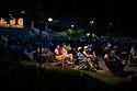 Spain - Barcelona -Barcelonians enjoying an open air jazz concert in Jardines Joan Maragall during the summer festival Musica als parcs.