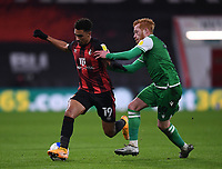 12th January 2021; Vitality Stadium, Bournemouth, Dorset, England; English Football League Championship Football, Bournemouth Athletic versus Millwall; Ryan Woods of Millwall held off the ball by Junior Stanislas of Bournemouth