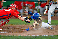 Keibert Ruiz (31) of the Ogden Raptors avoids the tag from Brennan Morgan (23) of the Orem Owlz  during the game in Pioneer League action at Lindquist Field on July 29, 2016 in Ogden, Utah. Orem defeated Ogden 8-5. (Stephen Smith/Four Seam Images)