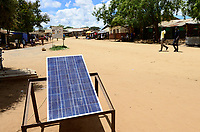 UGANDA, Karamoja, Kaabong, Karamojong pastoral tribe, solar panels for power generation and battery recharging