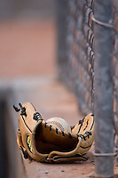 A glove and ball sit on the wall in the home dugout at Ernie Shore Field in Winston-Salem, NC, Saturday August 9, 2008. (Photo by Brian Westerholt / Four Seam Images)