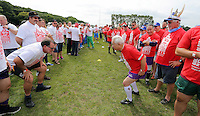 Pictured: Participants before the attempt in Cardiff, Wales, UK. Wednesday 24 August 2016<br />Re: The largest rugby scrum has been achieved by Golden Oldies at University Fields in Cardiff south Wales, UK. It was refereed by welsh international referee Nigel Owens. Guinness World Records has verified the new record in which 1297 people took part in.