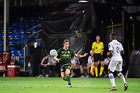 LAKE BUENA VISTA, FL - AUGUST 11: Jorge Villafana #4 of the Portland Timbers kicks the ball during a game between Orlando City SC and Portland Timbers at ESPN Wide World of Sports on August 11, 2020 in Lake Buena Vista, Florida.