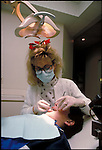 dental hygienist works on young patient