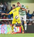 Villarreal's Nahuel holds off Celtic's Breslin .