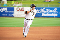 J.B. Shuck (3) of the Salt Lake Bees hustles towards third base against the Tacoma Rainiers at Smith's Ballpark on July 9, 2014 in Salt Lake City, Utah.  (Stephen Smith/Four Seam Images)