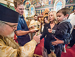 Veneration of the Holy Cross at the conclusion of Paschal Divine Liturgy with the distribution of the colorful easter eggs, St. Sava Serbian Orthodox Church, midnight in Jackson, Calif.