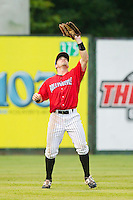 Kannapolis Intimidators left fielder Kale Kiser (9) settles under a fly ball during the South Atlantic League game against the Greensboro Grasshoppers at CMC-Northeast Stadium on July 13, 2013 in Kannapolis, North Carolina.  The Intimidators wore throwback jerseys of the Piedmont Boll Weevils, who played in Kannapolis from 1996-2000.   (Brian Westerholt/Four Seam Images)