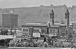 Oakland Section of Pittsburgh:  View the Carnegie Institute from Flagstaff Hill.  The Carnegie Institute (Library) is located to the right across the St Pierre Ravine.  Building Advertising: Keech's Furniture, Hershey's Cocoa, Tom Keene Cigars, Pickerings Furniture, Cubanola sheet music, and Red Raven Splits.