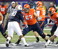ATLANTA, GA - DECEMBER 31: Austin Pasztor #63 of the Virginia Cavaliers blocks Gabe Wright #90 of the Auburn Tigers during the 2011 Chick Fil-A Bowl at the Georgia Dome on December 31, 2011 in Atlanta, Georgia. Auburn defeated Virginia 43-24. (Photo by Andrew Shurtleff/Getty Images) *** Local Caption *** Gabe Wright;Austin Pasztor